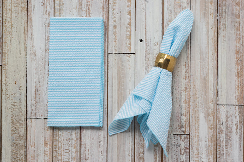 baby blue colored seersucker cloth napkins on table