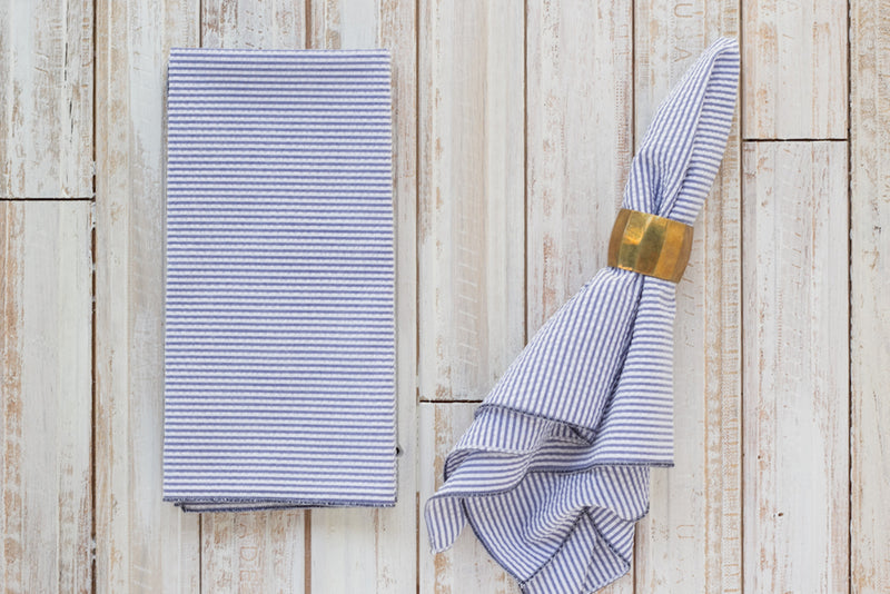 navy blue colored seersucker cloth napkins on table