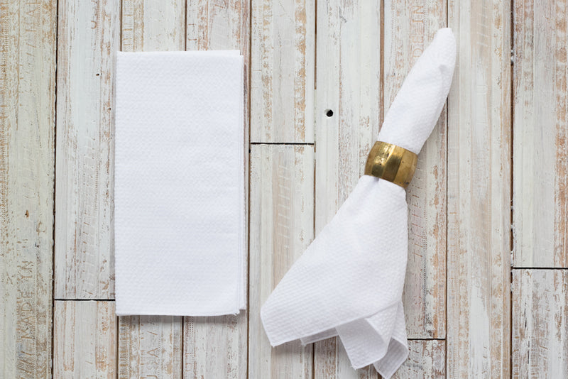 white colored seersucker cloth napkins on table