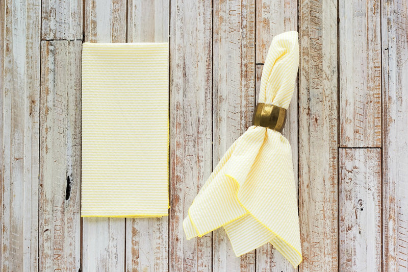 yellow colored seersucker cloth napkins on table