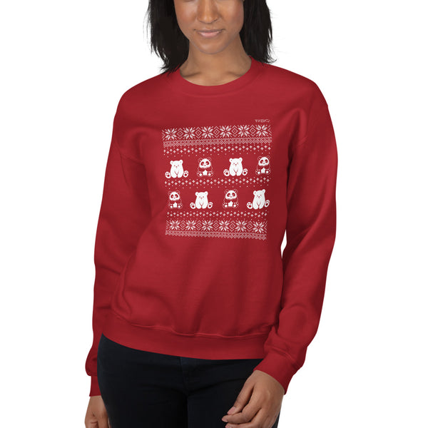 Winter Holiday Sweater design by P.M.B.Q. Studios. This design simulates a wintry knit pattern and features the Polo Cub character and his adorable panda friend. The design is white printed on a unisex red crewneck sweatshirt. The sweatshirt is worn by a female model.