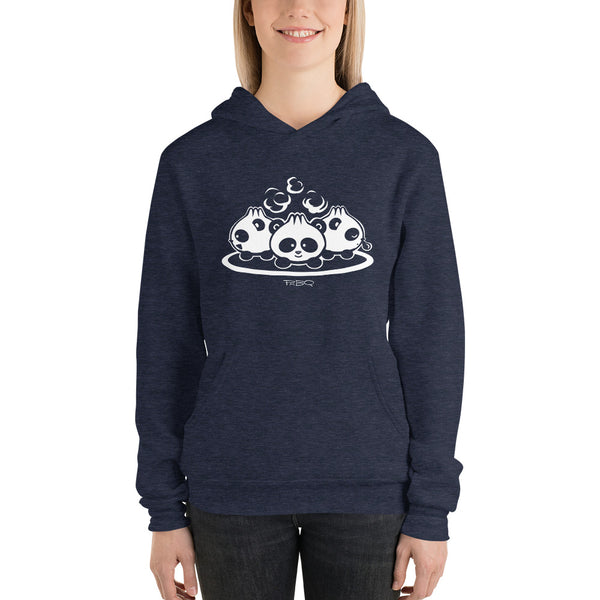 Pandabuns, characters created and owned by P.M.B.Q. Studios. These are three pandas that look like pork buns with steam puffing from the tops of their heads. This design is printed in white ink on a heather navy hooded pullover unisex sweatshirt. The sweatshirt is worn by a female model.
