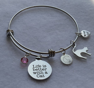 "Life is Better with a Cat Wire Bangle Charm Bracelet with 5 cat charms: Life is Better with a Cat Charm, Miau Miau Clothing Co. Brand Charm, Cat Silhouette Charm, I love my Cat Charm, Round Crystal Charm. 60 mm fits ~7"" to 8"" wrist 65 mm fits ~8"" to 9"" wrist. Crystal Color: Pink"