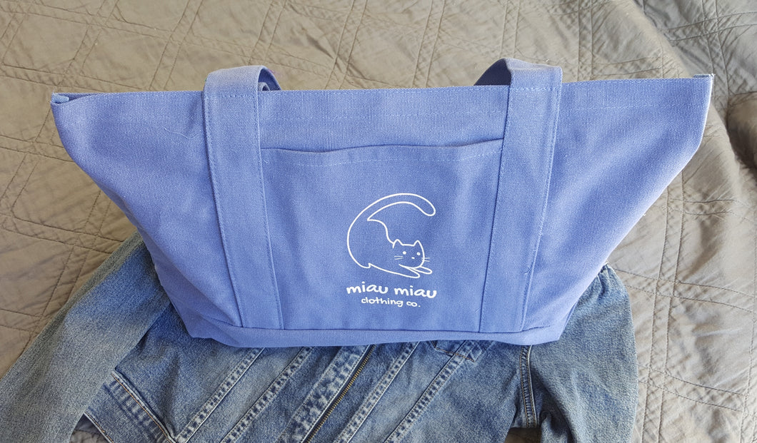 Vintage washed blue tote bag with side pocket with Miau Miau Clothing Co. logo