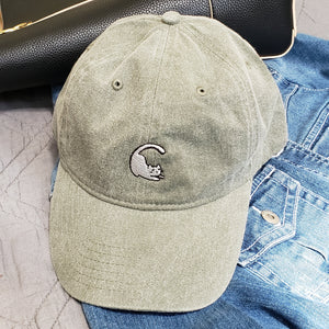 Vintage washed green baseball hat with embroidered cat logo on front.