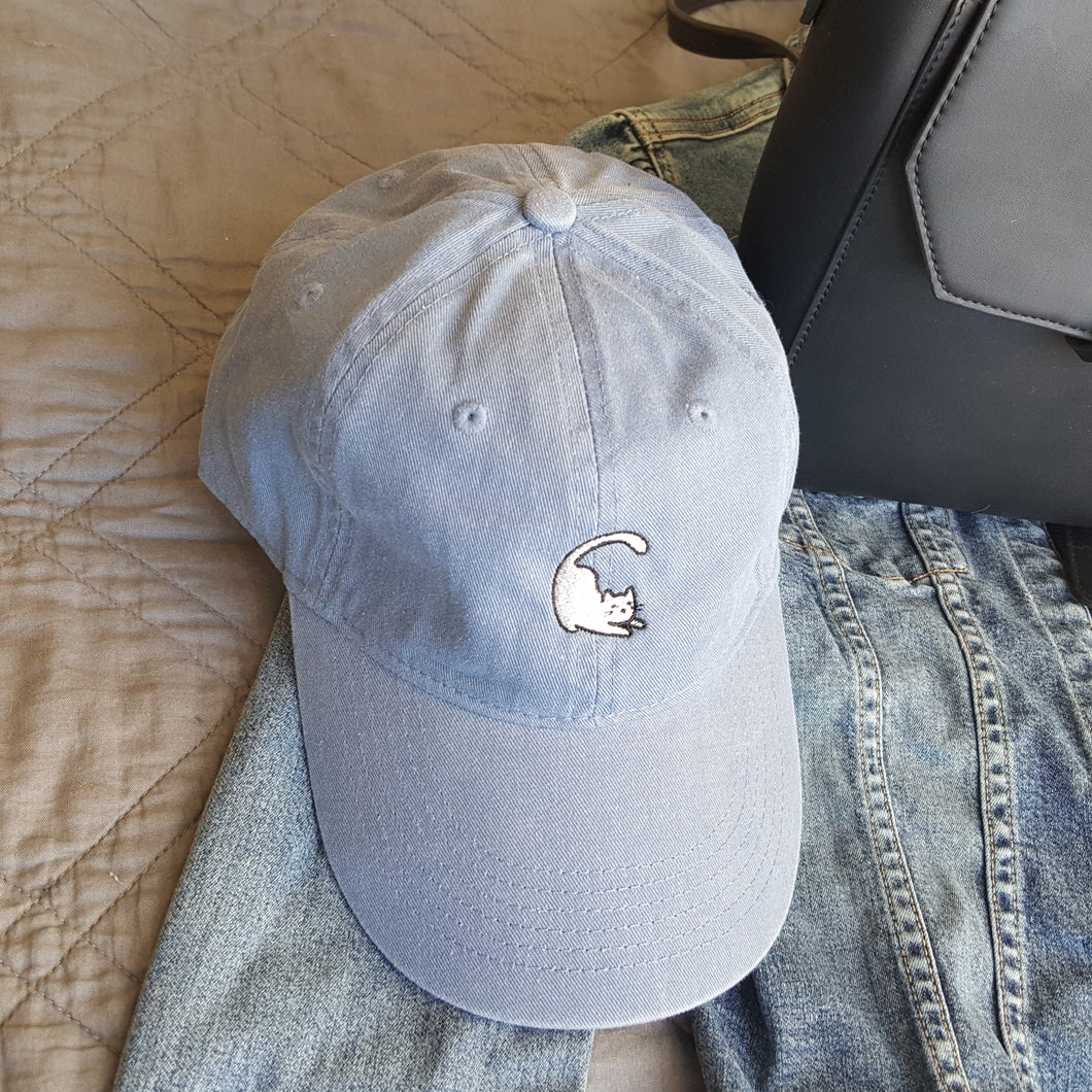 Vintage washed blue baseball hat with embroidered cat logo on front.