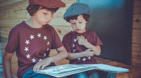 Photo of two boys reading