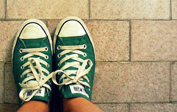 Photo of green converse trainers