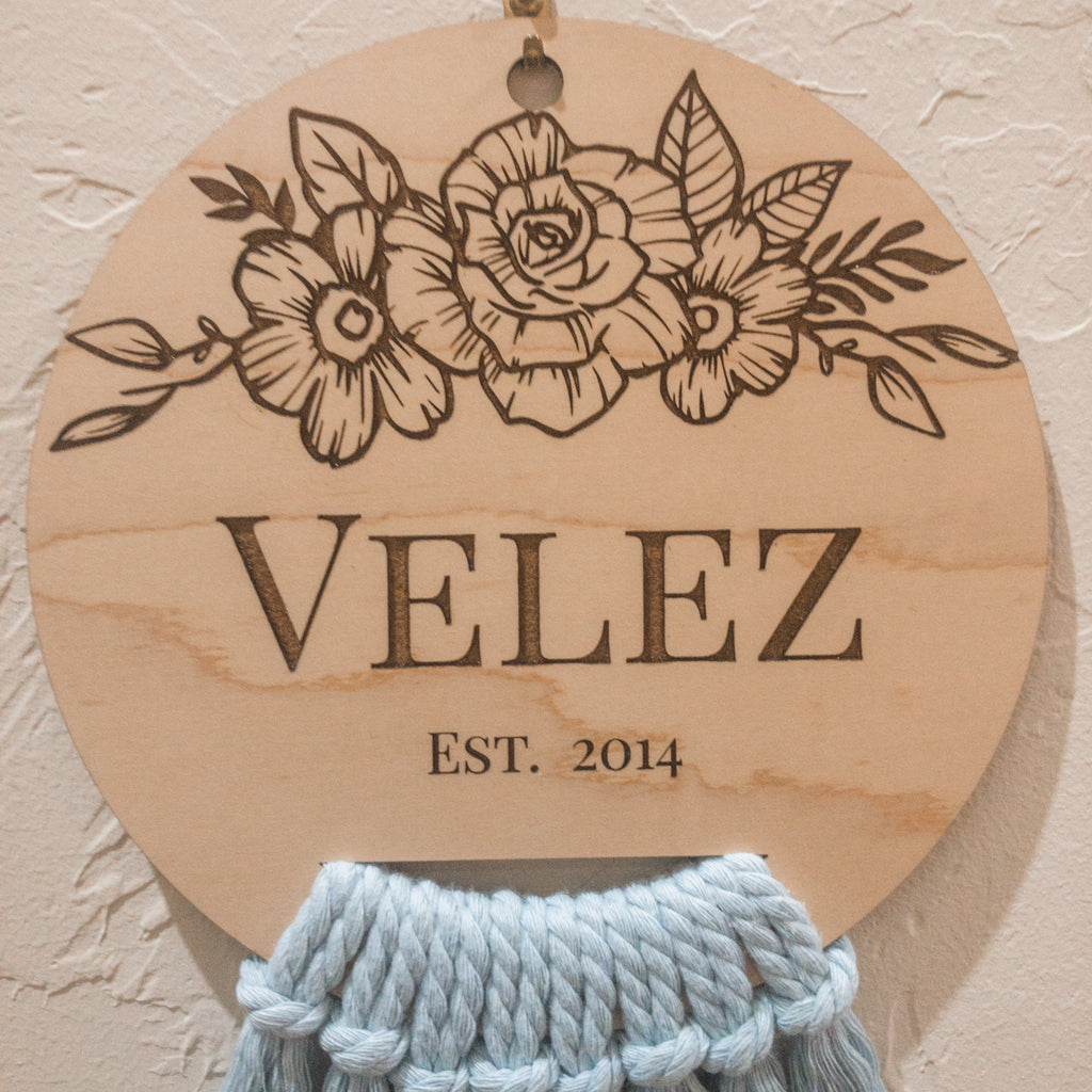laser engraved wood decor, maple wood, floral, personalized, last name, surname, established date, year, cord, boho, simple, minimalist, home decor, nursery decor, kiddos room, gift, natural, cute, adorable, roses, flowers, leaves, blue, cotton cord, rope, plaque, wood grain, ki+three, homemade, handmade, made in Oklahoma, made in the USA, MIO, small business