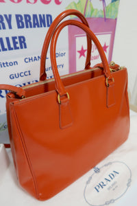 AUTHENTIC Prada Orange Saffiano PREOWNED (WBA117)