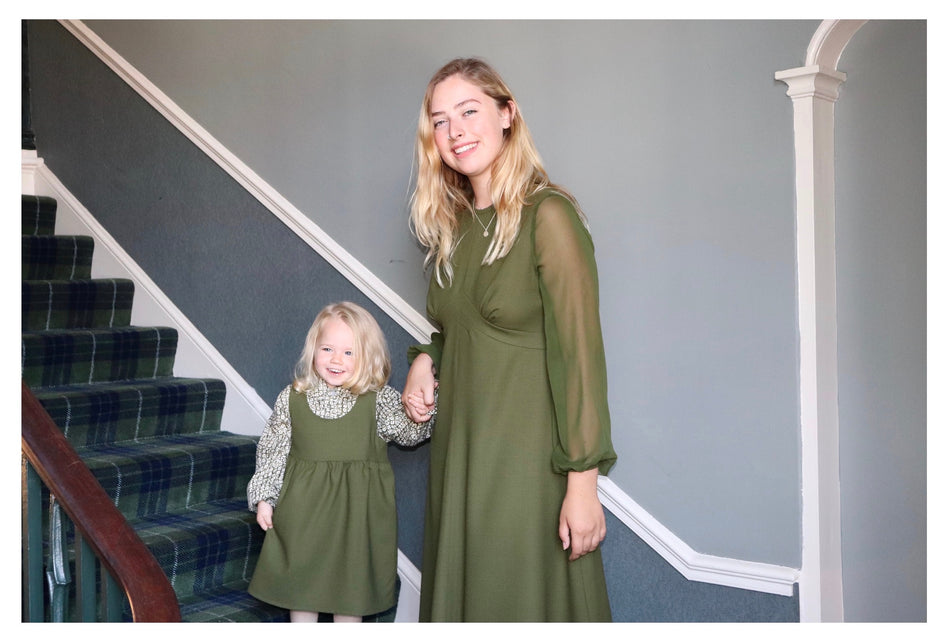khaki wool crepe cocktail dress for grown ups and coordinating khaki wool crepe pinafore and cupro blouse for little one by sustainable clothing brand  Atelier MorganMarsh