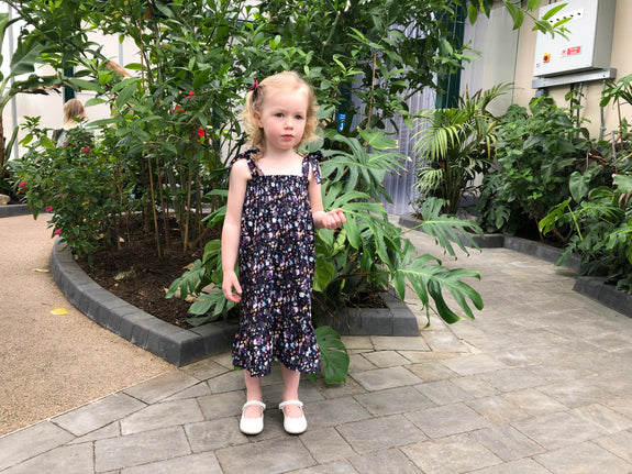 Ethically made Cotton Sun Dress for children with elasticated bodice, frill hem and tie shoulders in floral print by sustainable fashion brand Atelier MorganMarsh