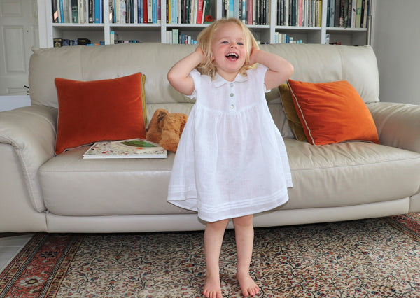 Child's white linen nightdress by sustainable fashion brand Atelier Morganmarsh