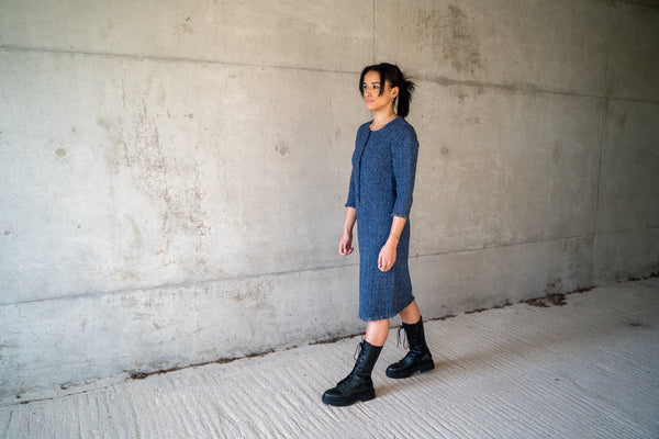 Sustainable and Ethical Fashion Collection: Blue cotton tweed dress with pure silk lining. Open front to the waist with covered buttons. Three quarter sleeves and hem are fringed.