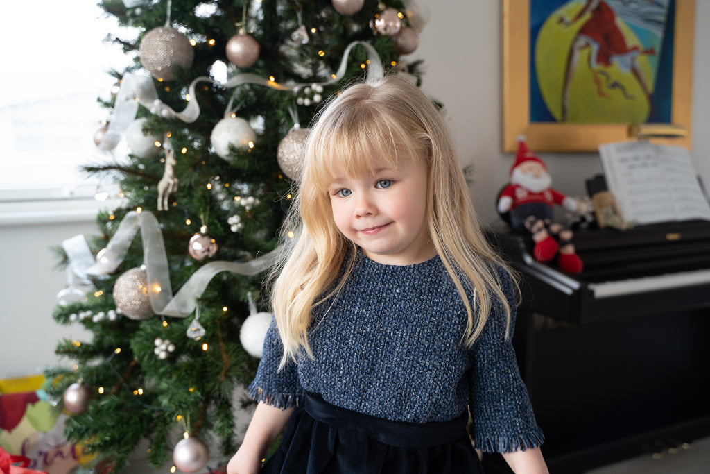 Sustainable and Ethical Clothing Collection for Children: blue tweed and cotton velvet dress with velvet covered buttons at the back - three quarter sleeves with fringed hems, just like mama