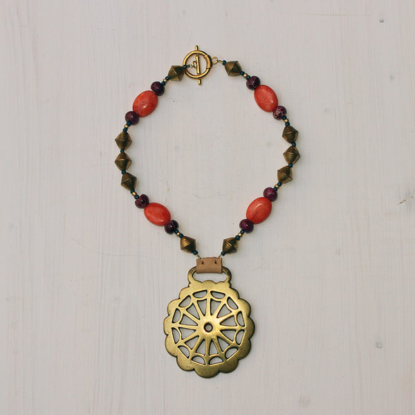Geometric Design with Coral, Brass, and Pink