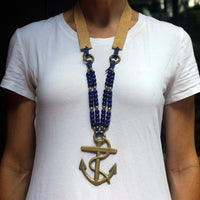 Anchor horse brass necklace on model