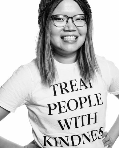 Woman with t-shirt that says treat people with kindness