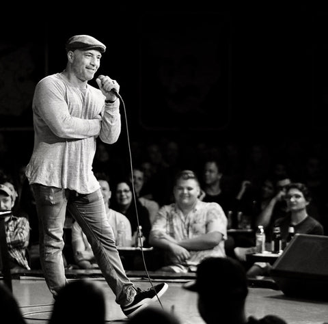 Joe Rogan on stage with microphone