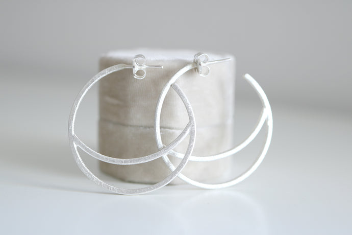 Lluna medium earrings. Sterling silver Moon hoop earrings