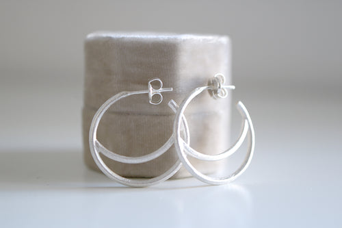 Lluna small earrings. Sterling silver Moon hoop earrings.