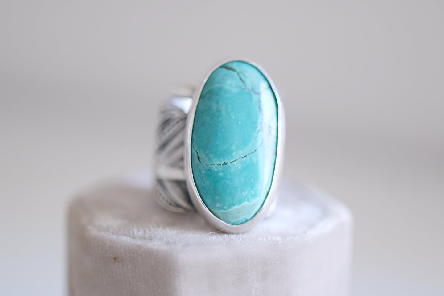 Turquoise and Feather ring. Sterling silver Turquoise ring with Feather band.