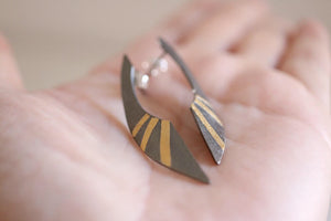 Aton earrings. Black sterling silver earrings with 24kt gold.