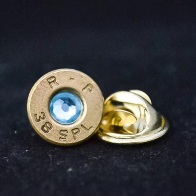 .38 special brass lapel pin with blue swarovski crystal