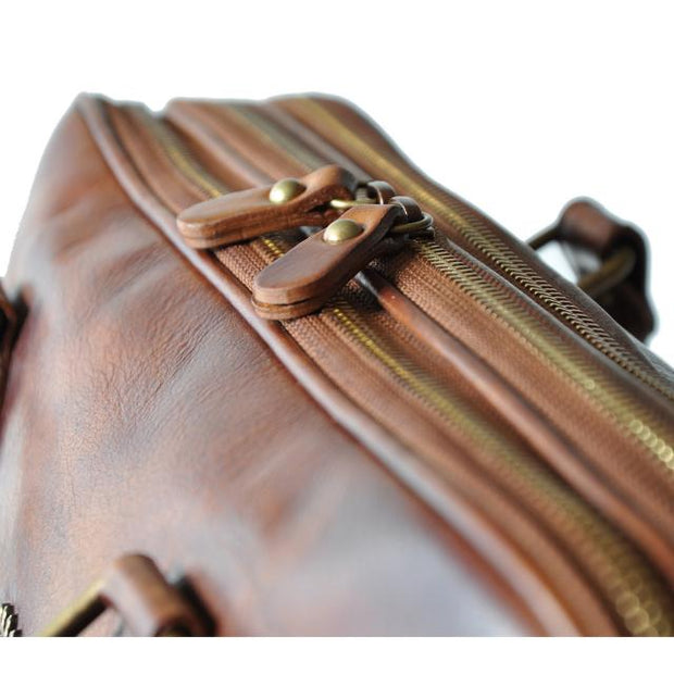 Close-up of Pratesi brown Magliano bruce leather briefcase.
