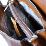 Inside of Pratesi brown Baratti leather handbag.