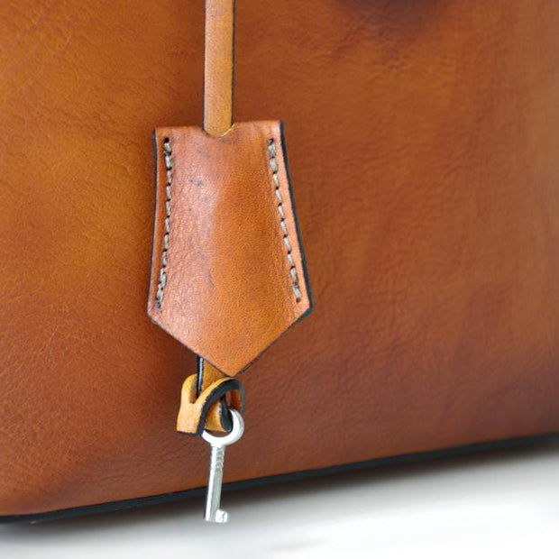 Close-up of Pratesi Versilia brown leather hand bag.