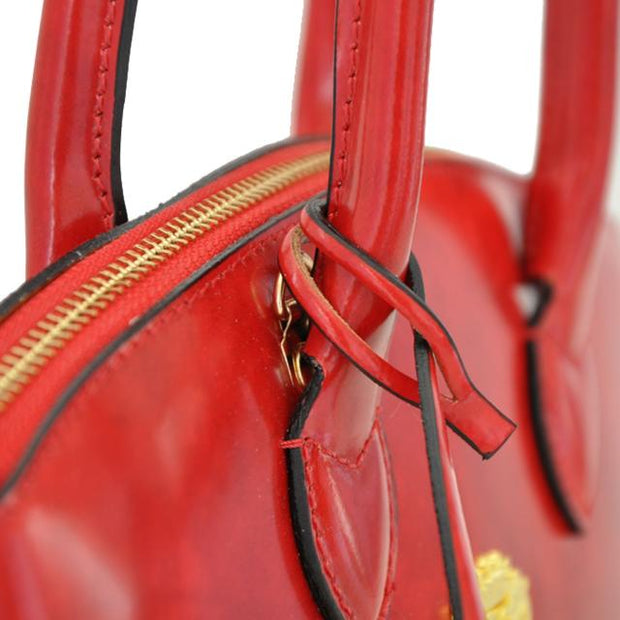 Close-up of Pratesi Versilia Small red leather hand bag.