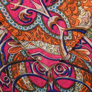 Close-up of Belmore Boutique pink Celtic print silk scarf.
