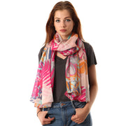 Belmore Boutique pink and purple floral print silk scarf on model.