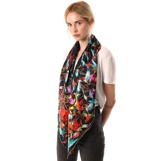 Belmore Boutique black and gold hummingbird print silk scarf on model.