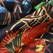 Close-up of Belmore Boutique black and gold hummingbird print silk scarf.