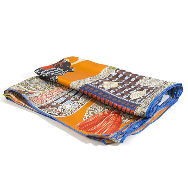 Belmore Boutique green and orange print silk scarf.