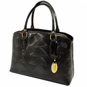 Giordano Mary black patent leather handbag.