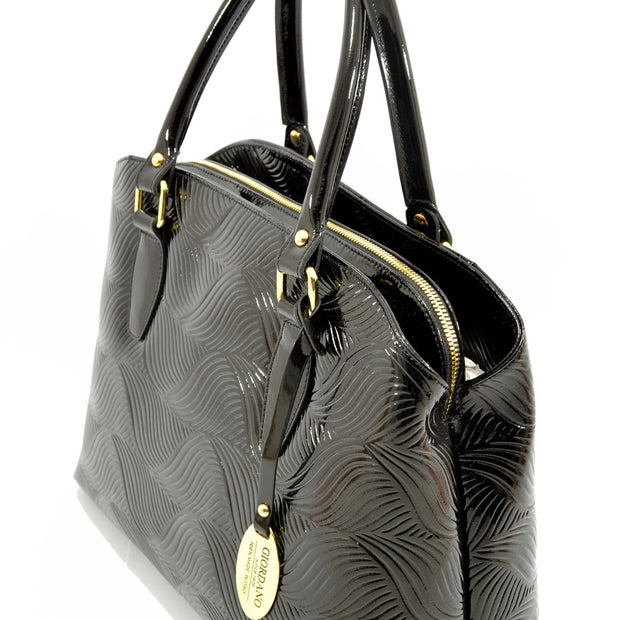 Side of Giordano Mary black patent leather handbag.