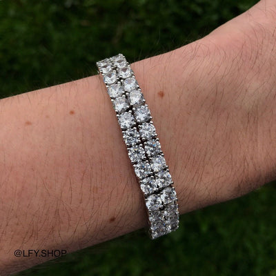 10mm ICED 2 Row Tennis Bracelet in White Gold, shown being worn on a man's wrist, best out.