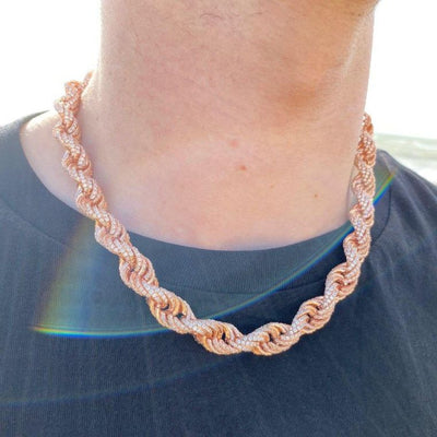 10mm ICED Rope Chain in Rose, shown being worn around a man's neck, best out.