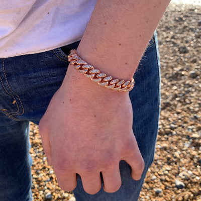 12mm ICED Cuban Bracelet in Rose Gold, shown being worn on a man's wrist, best out.