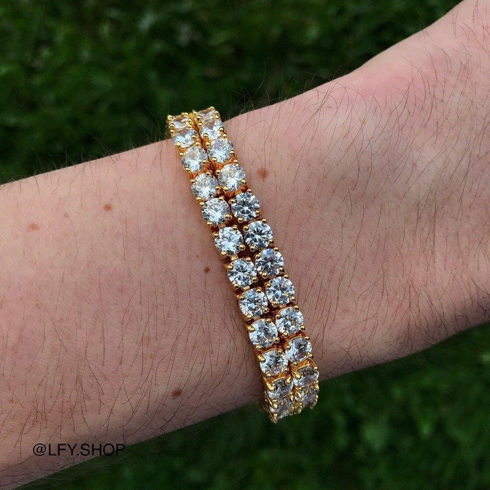 ICED 10mm 2 Row Tennis Bracelet in Gold worn on a wrist bling out of this world.