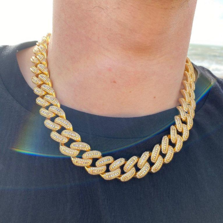 19mm LFY ICED Baguette Cuban Chain in Gold shown being worn around a man's neck on the beach, best out.