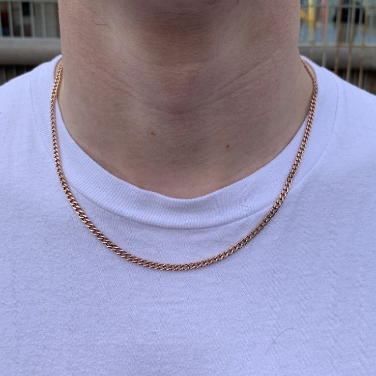 3mm Cuban Chain in Rose Gold shown being worn around a man's neck.