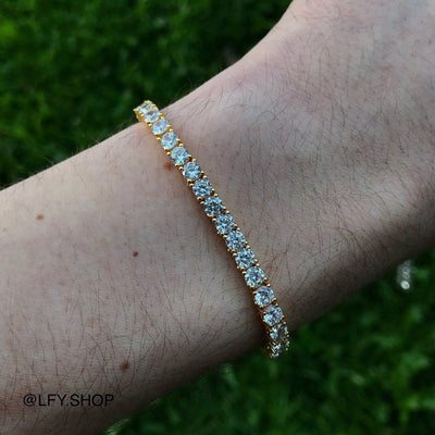 4mm ICED Tennis Bracelet in Gold shown being worn on a man's wrist, best out.
