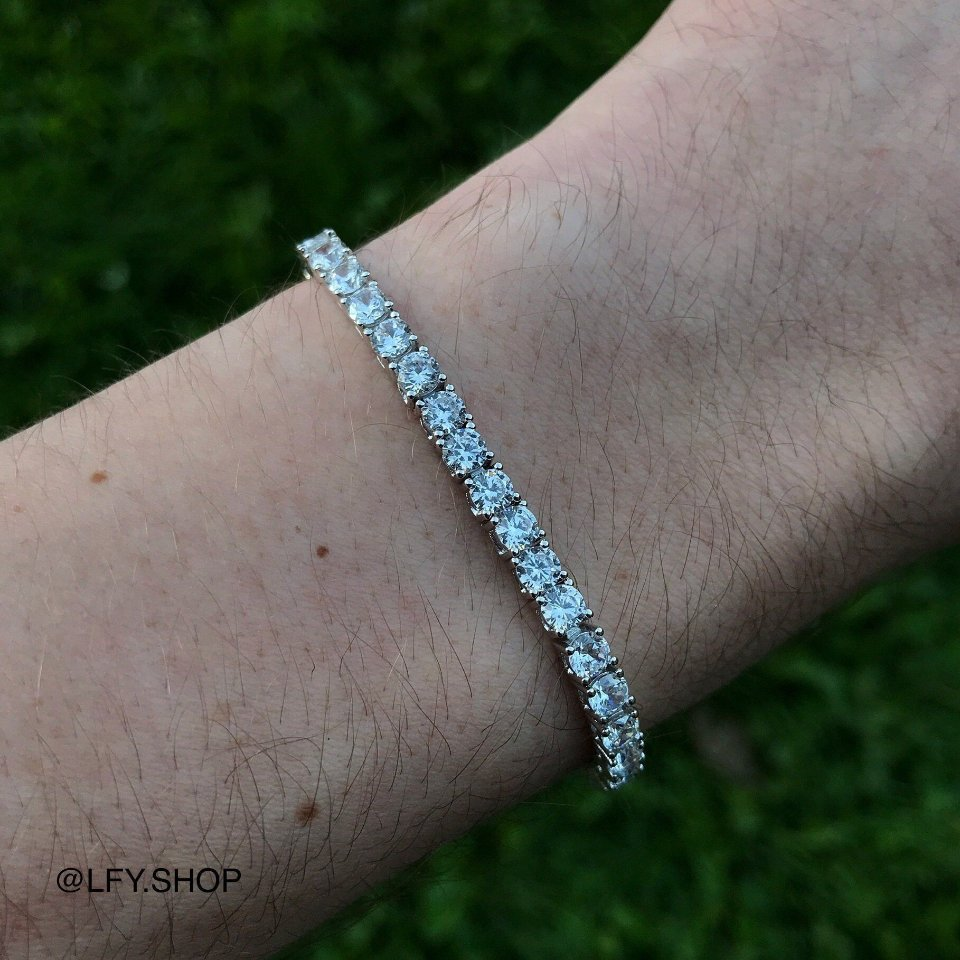 4mm ICED Tennis Bracelet in White Gold shown being worn on a man's wrist.
