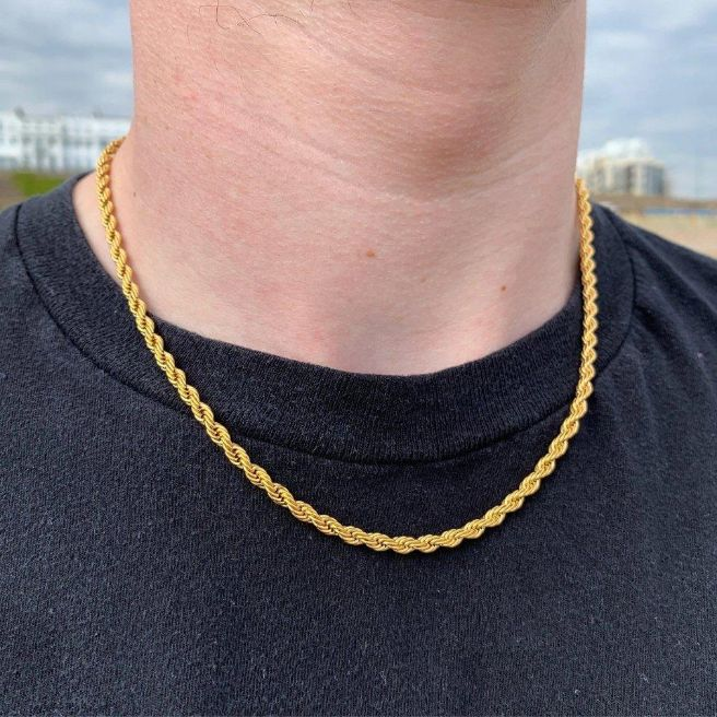 4mm Rope Chain in Gold shown being worn around a man's neck on the beach.