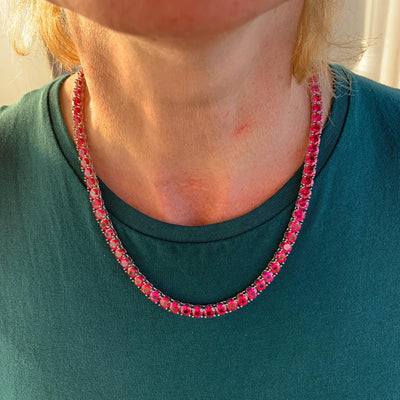 6mm ICED Tennis Chain in White Gold (RED CZ) shown around a woman's neck, best out.