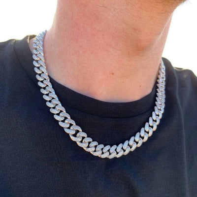 12mm ICED Cuban Chain in White Gold shown being worn around a man's neck, best out.